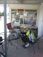 Brazilian cycling dude (Roberto at the St. Francis Dairy King) and Kansas flag-woman. Who has the prettier hi-vis clothing?