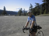 Don't just look ahead on climbs. The reverse views can be stunning too. Mike Sturgill with Mount Rainer in the distance.