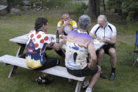Kieth Nichol (L), Bob Bruce (R), Greg Courtney (sleeveless) and others catching up on war stories over supper.
