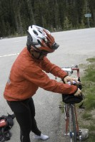 Yutaka Moriwaki of Japan was one tough rider. Here he is layering up on the top of Rainy Pass summit (4855 ft).