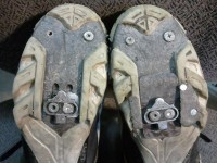 Shims to correct for varus (smaller shim on the left) and leg length inequality (larger black shim on the right). I have since then gone to a BikeFit.com 1° varus cleat on both shoes).